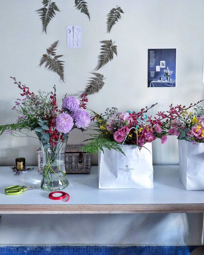 sets of different floral displays, with colorful bouquet in a vase or in a paper bag
