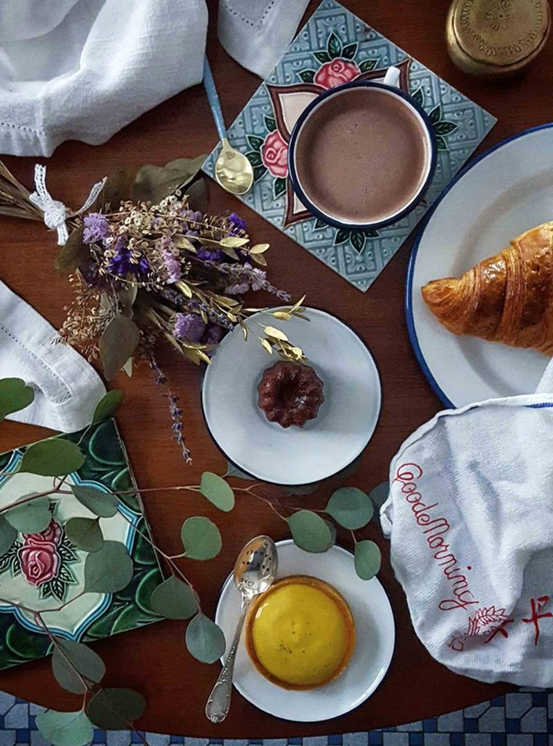 set up of some french pastries, hot chocolate and some dried lavender flowers to create an typical south of France ambiance