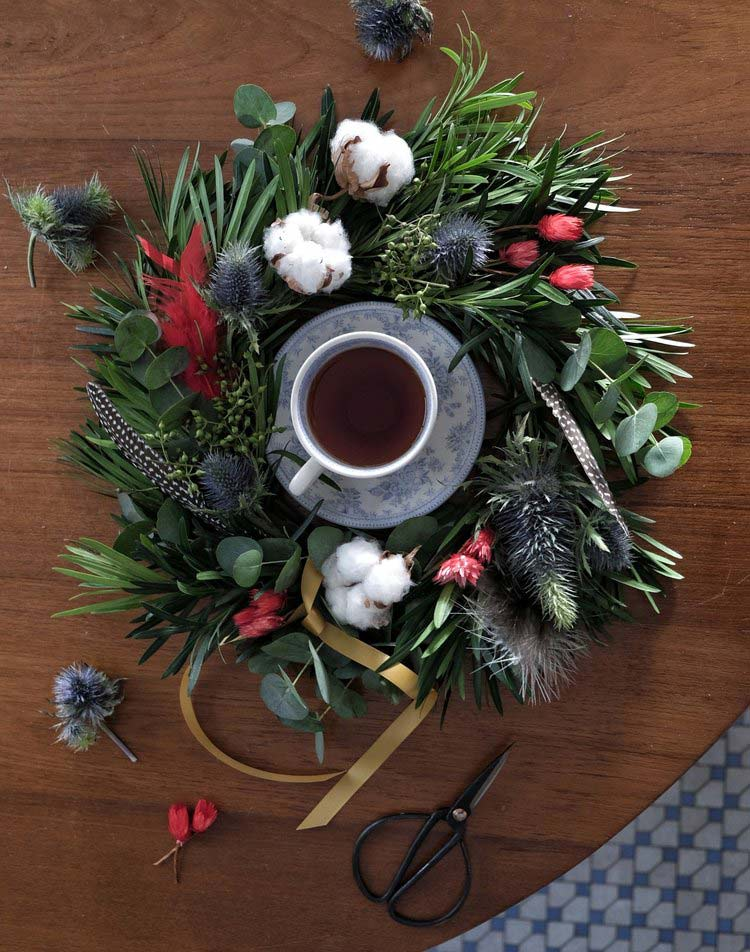 Christmas wreath made around a blue cup of tea