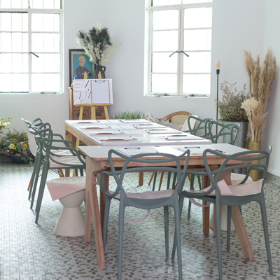 a flower workshop session with tables and chairs